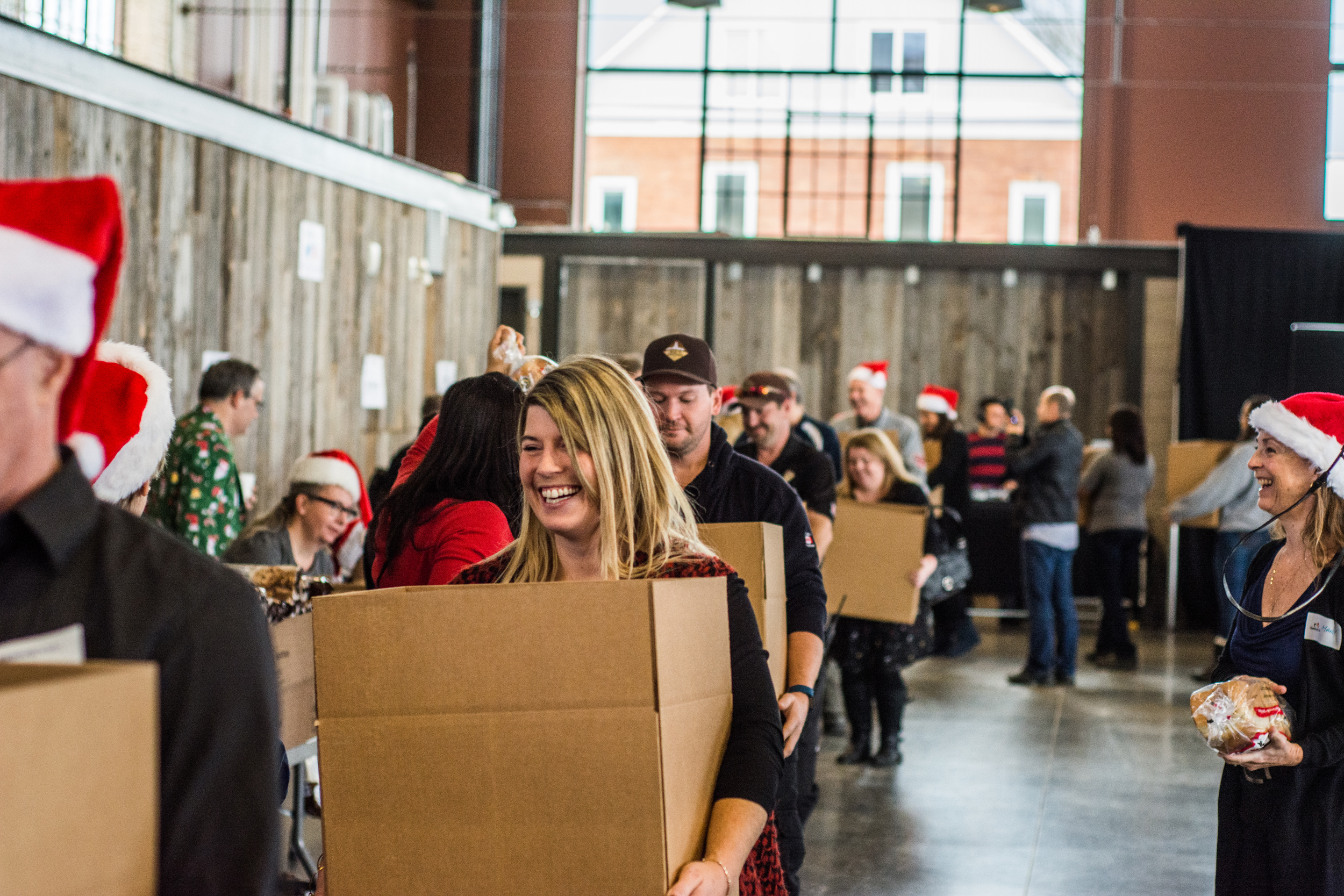 Corporate teams pack hampers at Ottawa's Annual Hamper-Packing Day (2017)
